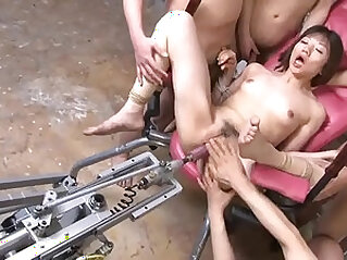Petite Japanese babe gets pounded by a fuck machine