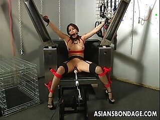Busty brunette woman getting her wet pussy machine fucked