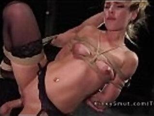 Squating blonde hard flogged