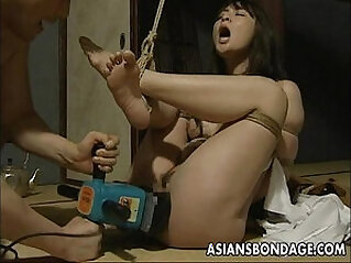 Tied up Japanese hottie gets fucked hard with machine