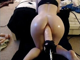 babe takes dildo in her ass by machine