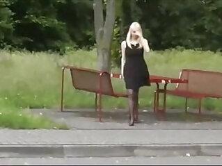 Dogging slut loves to tease in public toliet