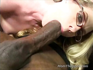 Sexy brunette MILF sucks on a big black girl with huge cock that stuffs her whole mouth