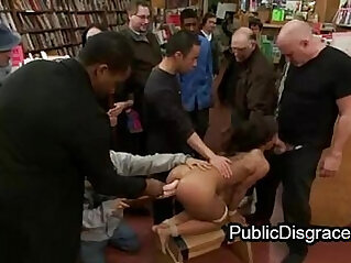 Bound babe gets anal fucked in book store
