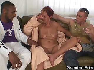 Granny gets pussy nailed from both sides