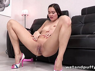 Sexy brunette babe teasing her lovely pussy