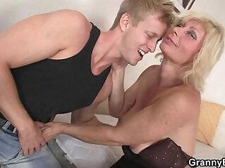 Granny blonde rides his stiff dick